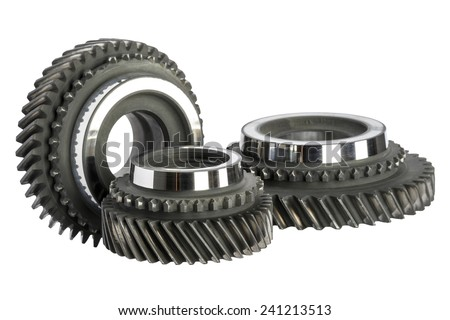 Three worn cog wheels removed from the main shaft of gearbox - stock photo