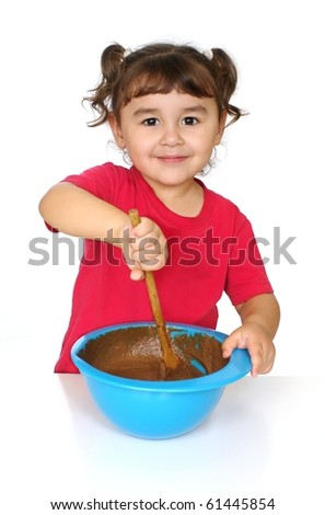 Three-year-old Hispanic girl mixing a bowl of chocolate cake batter, smiling, isolated on pure white background - stock photo