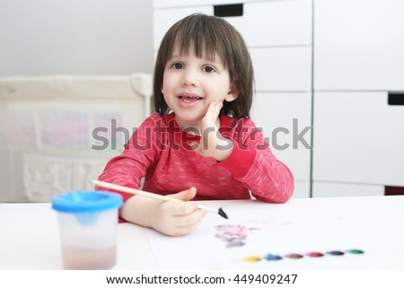Three-years boy is painting with watercolor - stock photo
