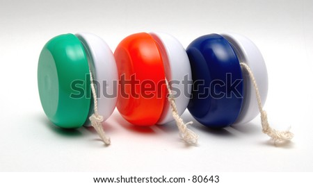 Three Yo Yo's in a Row - stock photo