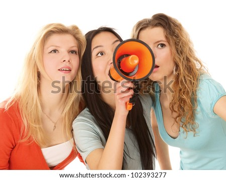 Three yong girls making announcement isolated on white background - stock photo