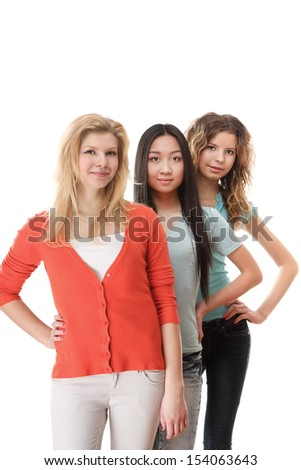 Three yong girls standing isolated on white background - stock photo