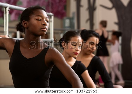 Three young ballet dancers in a dance studio - stock photo