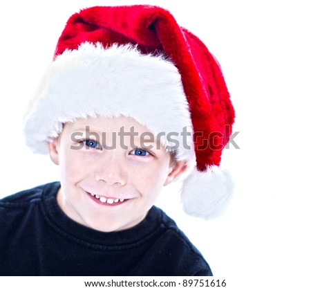 Three young boys studio portrait wearing santa hats - stock photo