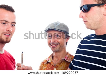 Three young excited guys sharing hashish joint, isolated on white background. - stock photo