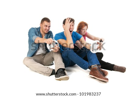 Three young friends ar gaming with the computer - stock photo