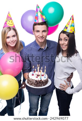 Three young friends having fun on birthday party. White background. - stock photo