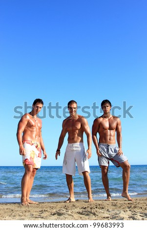 Three Young friends Relaxing On the Beach - stock photo