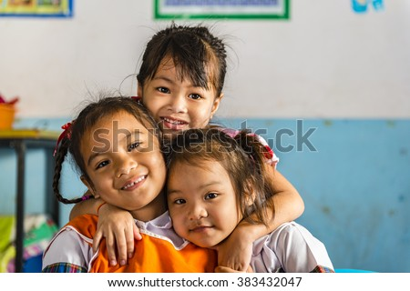 Three young girls girlfriends in a thai school. Thai school in a small village - stock photo