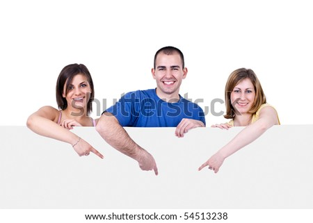 three young happy people holding a blank white card - stock photo