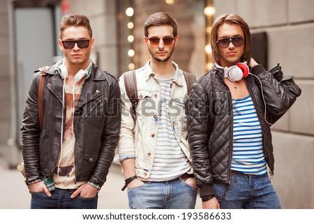 Three Young men fashion  - stock photo