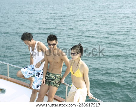 Three Young People Having Yacht Party - stock photo