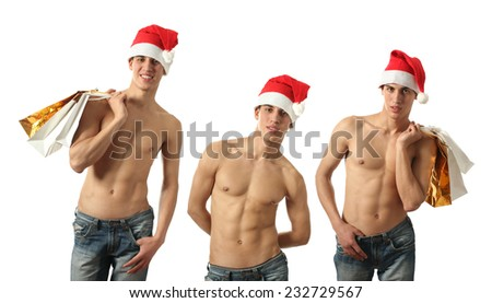 Three young sexy men wearing Santa Claus hats and with shopping bags isolated on white - stock photo