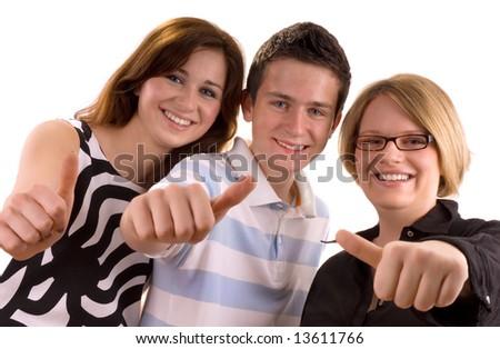 three young teenagers giving the thumbs-up sign - stock photo
