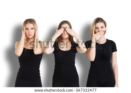Three young woman in black clothes isolated at white background showing blind, deaf and dumb: wise monkey scene - hear no evil, see no evil, speak no evil - stock photo