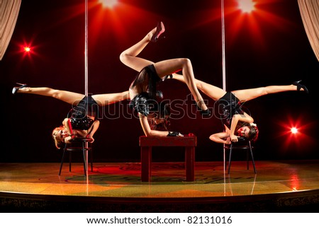 Three young women acrobatic show. - stock photo