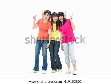 Three young women and doing victory sign  - stock photo