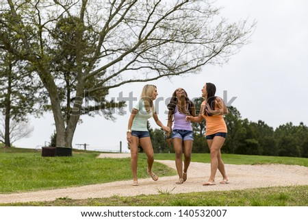 Three young women enjoying a day at the park - stock photo