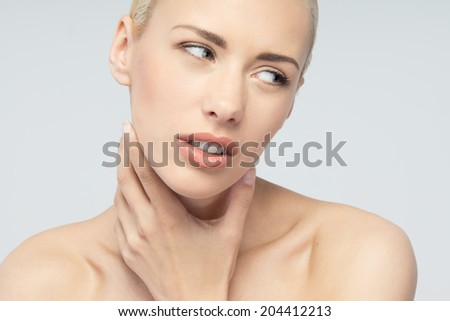 Throat pain concept. Young attractive blonde woman touching her throat isolated on white background - stock photo