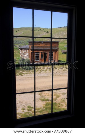 Through a window view of an old house. Ghost town, Bannack State Park, Montana - stock photo