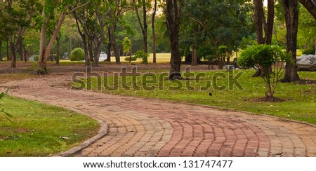 Through the park for jogging or rest - stock photo