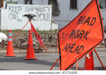 Throughout tornado torn cities you'll find such signs as these as the massive cleanup still continues months after disaster hit multiple states in the US. - stock photo