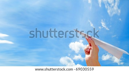 Throwing a paper plane in the sky. Freedom, success, vacation, business concepts - stock photo