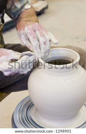 Throwing pottery 4 - stock photo