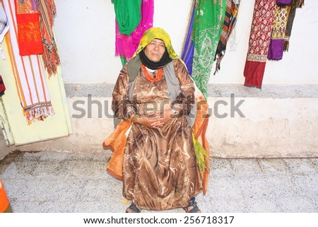 THULA, YEMEN - DECEMBER 2009: unidentified woman sells scarfs on December 01, 2009 in Thula. Yemenis are happy when tourists make photos from them. - stock photo