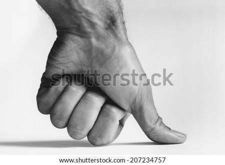 Thumb Pressing Down - stock photo