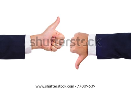 Thumb up and thumb down hand signs isolated on white - stock photo