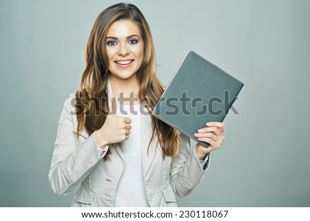 thumb up. business woman hold book isolated studio background. - stock photo