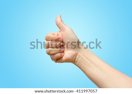 thumb up on blue background, good job concept - stock photo