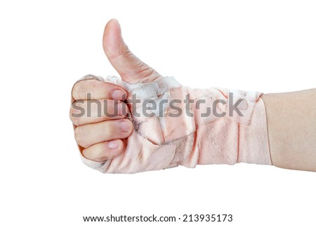 Thumb up showing by hand with bandages isolated on white background - stock photo