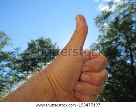 thumbs up and blue skies - stock photo
