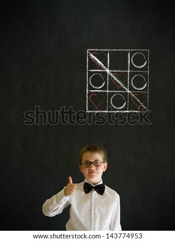 Thumbs up boy dressed up as business man with chalk tic tac toe love valentine concept on blackboard background - stock photo