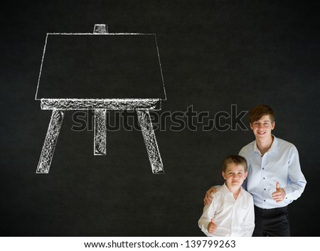 Thumbs up boy dressed up as business man with teacher man and learn art chalk easel on blackboard background - stock photo