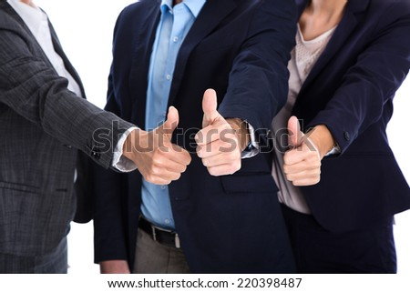 Thumbs up: business people making symbol for success, yes or partnership. - stock photo