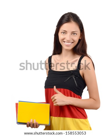 Thumbs up. Learn German. Beautiful student with Germany flag blouse holding books. Isolated on white. - stock photo