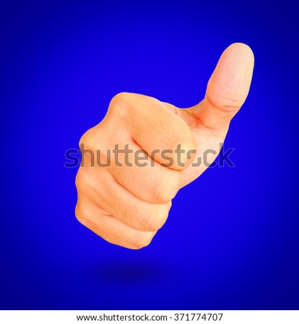 Thumbs Up on blue background - stock photo