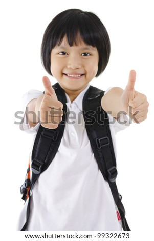 Thumbs up primary school girl with backpack on white background - stock photo