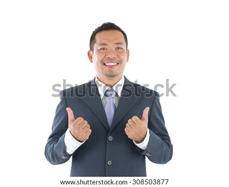 Thumbs up 40s indonesian businessman giving thumbs up over white background - stock photo
