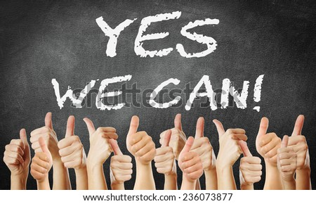 thumbs up - Yes We Can - stock photo
