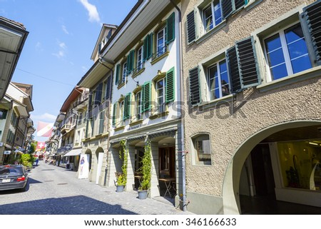 THUN, SWITZERLAND - SEPTEMBER 08, 2015: A general view of one of the picturesque streets of the city of Thun with a population of approx. 45000 residents, it is a city located in the Canton of Bern - stock photo