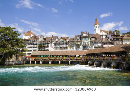 THUN, SWITZERLAND - SEPTEMBER 08, 2015: View towards the old town. Thun with a population of approx. 45,000 citizens it is a city located in the canton of Bern, situated on the River Aare - stock photo