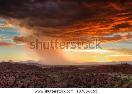 Thunderclouds at sunset over Damaraland, Namibia, Africa - stock photo