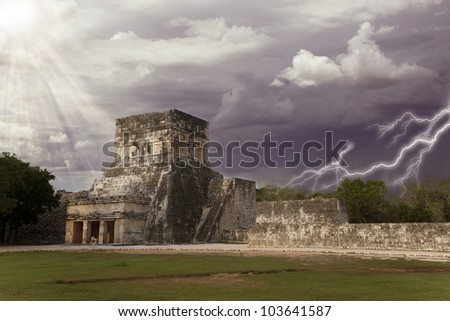 thunderstorm and sun under mayan ruins Chichen Itza Mexico - stock photo