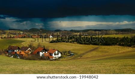 Thunderstorm coming over bavarian village near Munich, Germany - stock photo