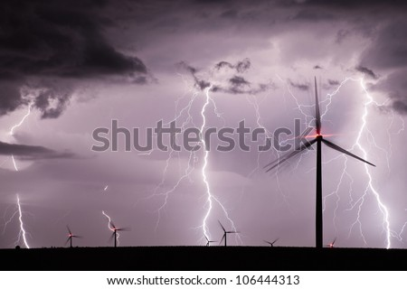 Thunderstorm over a wind farm - stock photo