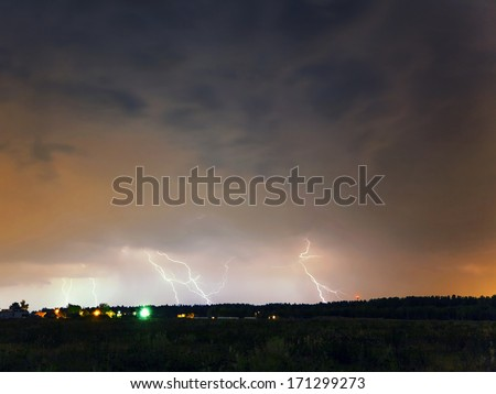 Thunderstorm with lightning in summer field  - stock photo